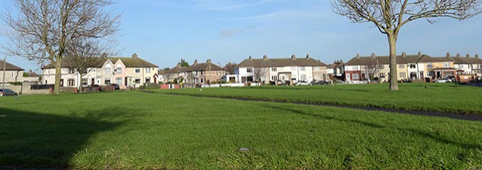 A view of a park with houses in the background in Crumlin.