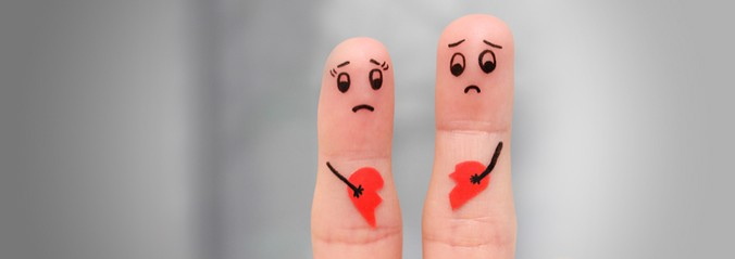 Finger Art - Two fingers with faces on the fingertips and a broken heart between them.