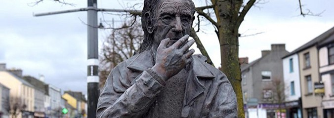 Statue of man with his hand on his face