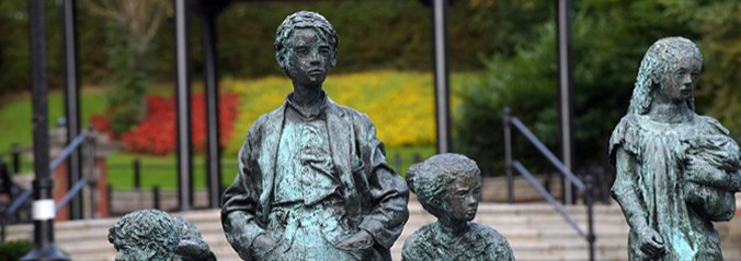 Statues of boys and girls with steps in background